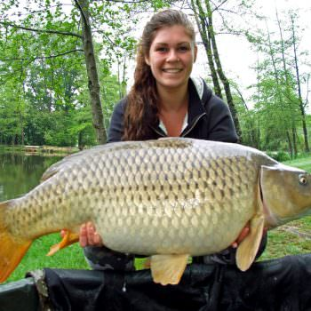 Lucy with Nicky a common carp at 34lbs
