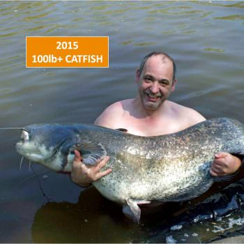 angler with a 105lb catfish in france