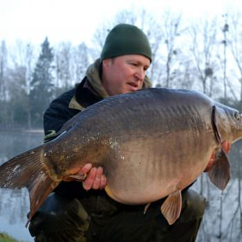 angler-with-32-pound-mirror-carp-in-france-morning