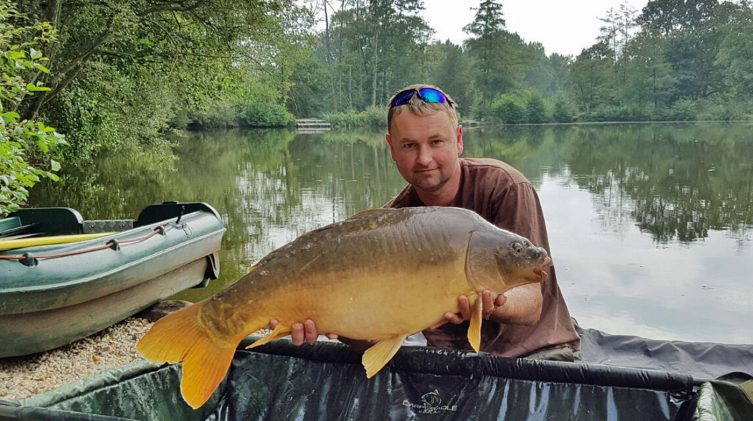 Mark with a 25lbs 8oz mirror carp in France in September