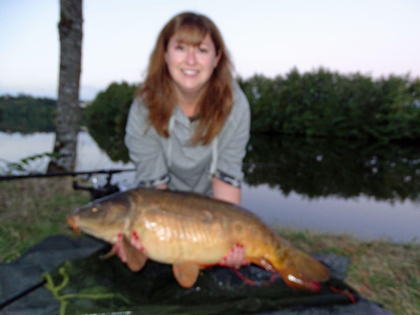 Amy with a 27lb 4oz mirror river carp
