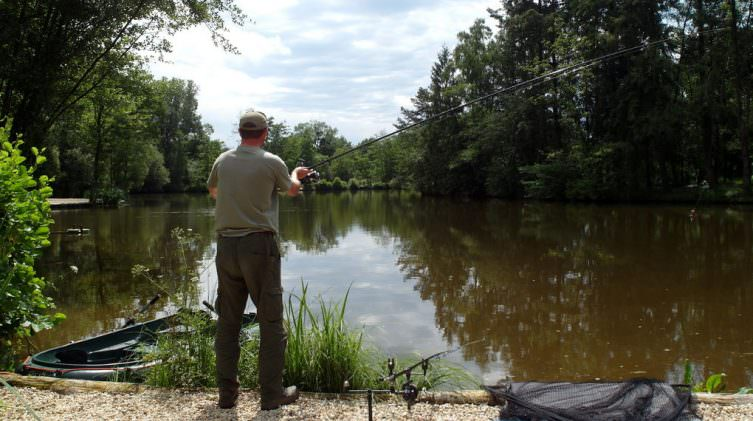 angler casting from home swim at french carp lake tips