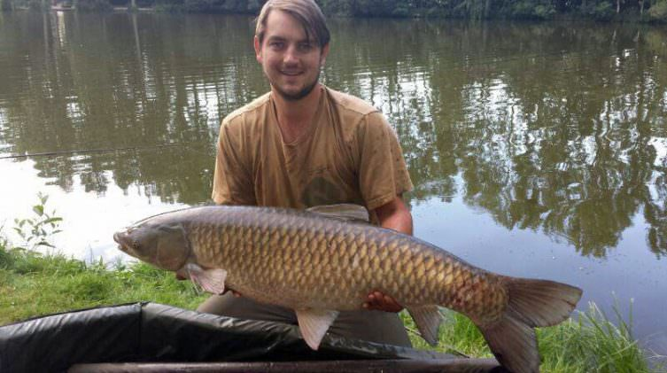 Jon with a 38lbs grass carp