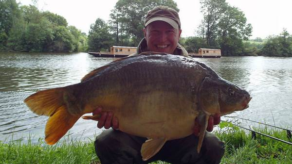 My first river carp at 24lbs 12oz taken on home made 20mm Blue Oyster boilies balanced with a Dynamite fluoro popup