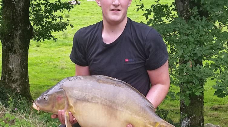 Charlie with a 32lbs mirror carp at beausoleil