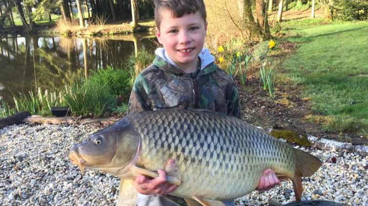 Lennon with Jess at 33lbs 8oz common carp