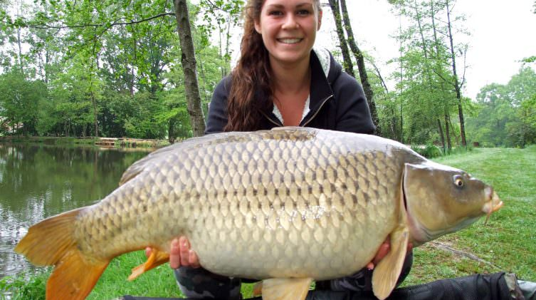 Lucy-with-Nicky-a-common-carp-of-34lbs
