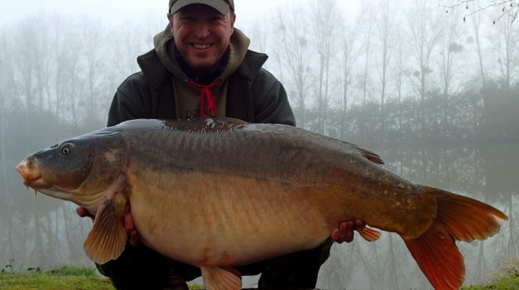Matt with greyscar a mirror carp of 48lbs 4oz in spring
