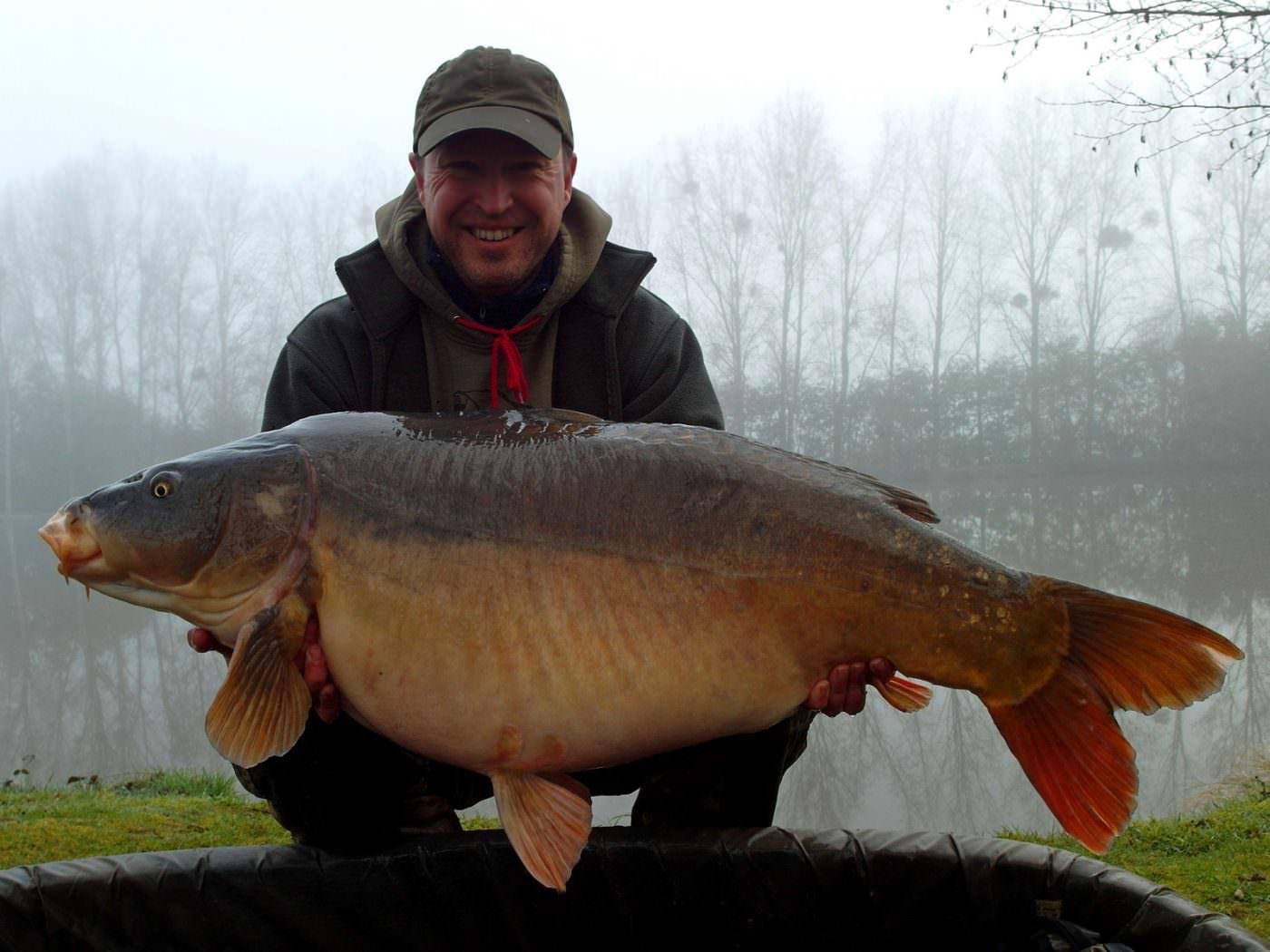 Matt with greyscar a mirror carp of 48lbs 4oz in spring