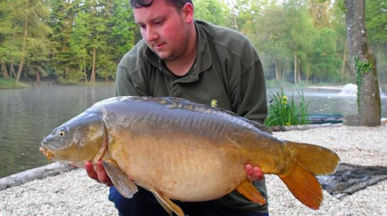 Mike-with-a-28lbs-8oz-mirror-carp