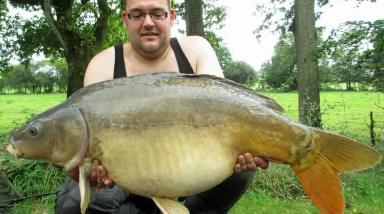 Stefan with Cornflake a mid thirty mirror carp
