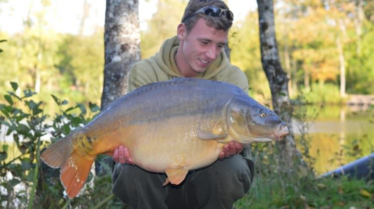 belgian angler Neils with a mirror carp of 31lbs in france