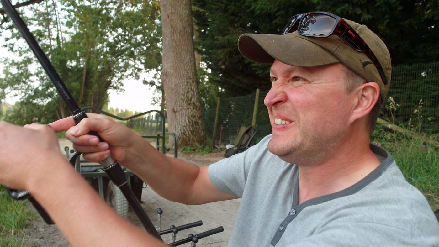carp fishing in-action-on-the-river