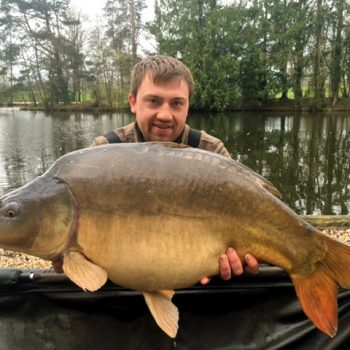 carp fishing in france angler with 37lbs 8oz mirror