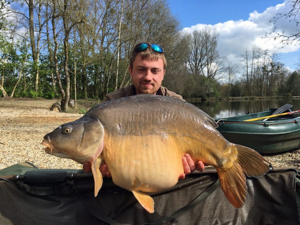 angler carp fishing in france with 35lbs mirror carp