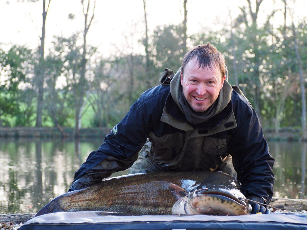 Matt with a 57 pounds catfish