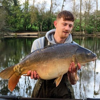 angler carp fishing in france with a mirror carp 32lbs