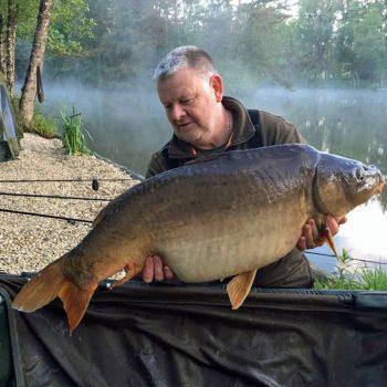 Tony with Monkfaire at 33lbs and 14oz mirror carp