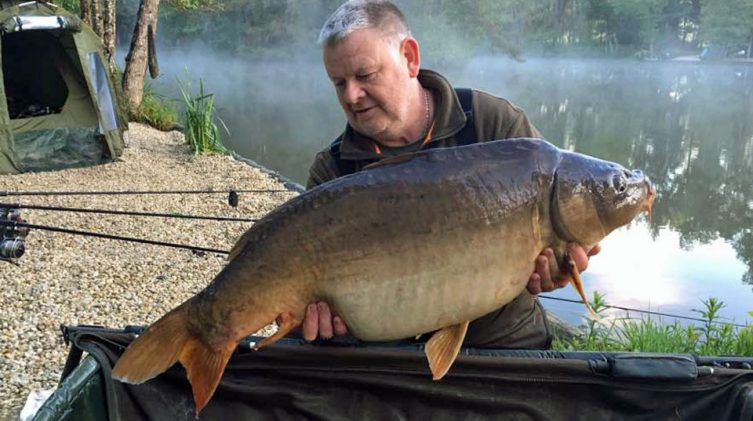 Tony with Monkfaire at 33lbs and 14oz mirror carp
