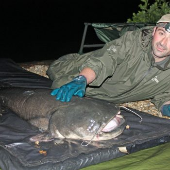 Simon with a 93lbs catfish
