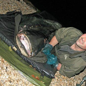 Simon with a 98lbs catfish