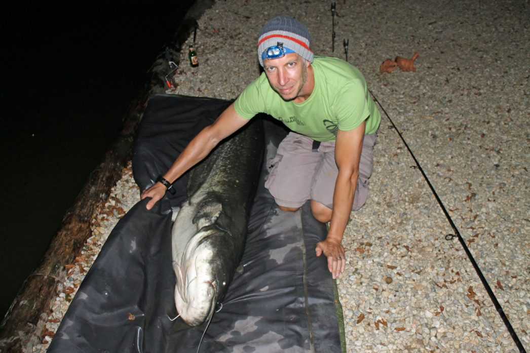 Steven with a 100lb catfish