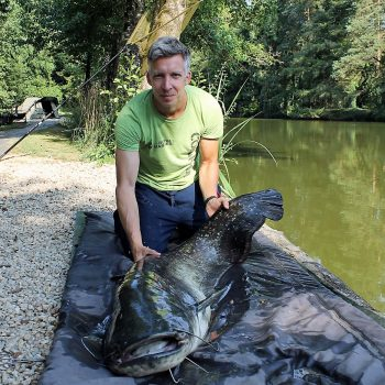 Steven with a 75lb catfish
