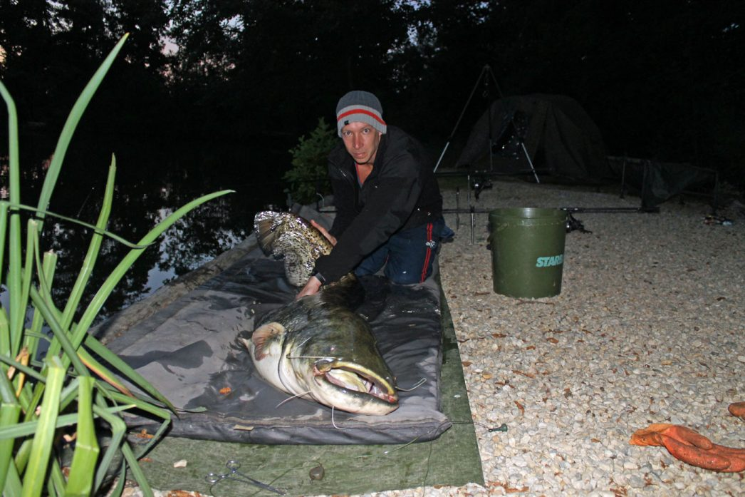 Steven with a 79lb catfish