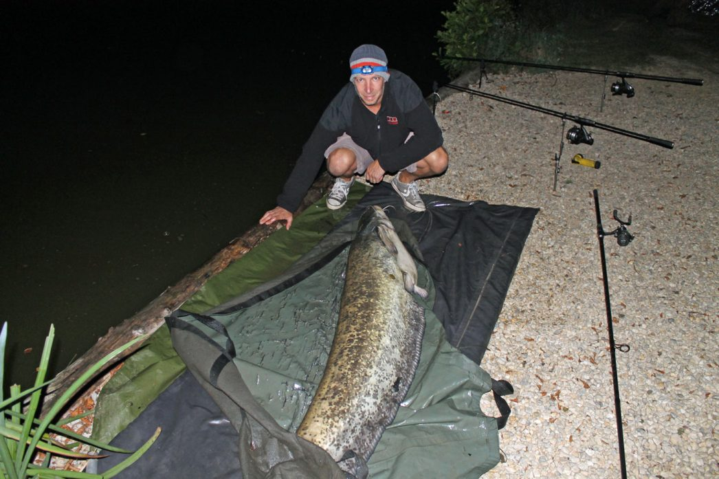 Steven with an 88lb catfish