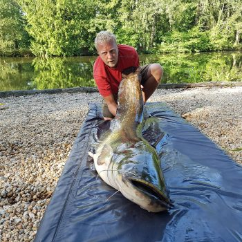 Stuart with his first catfish at 88lbs 12oz