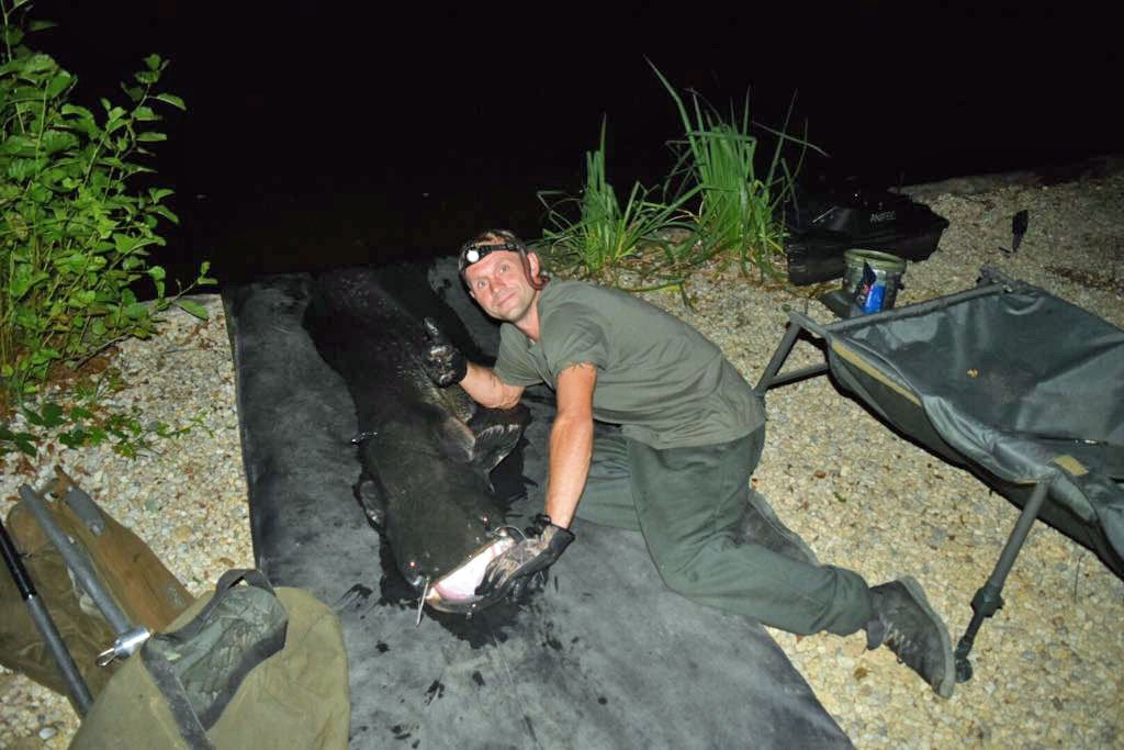 Chris with an 88lbs catfish