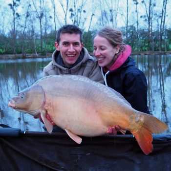Alexandre with a mirror carp of 38lbs in the winter