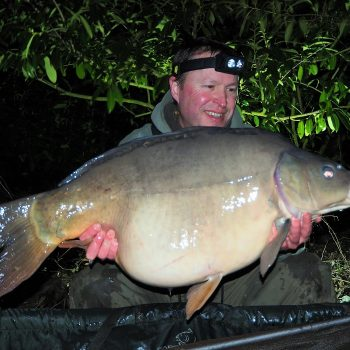 Matt with a 33lbs mirror carp in winter
