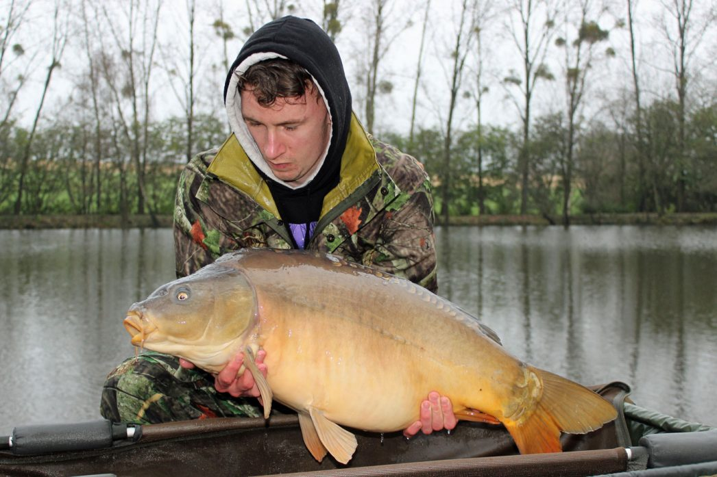 Ashley with a mirror carp of 30lbs