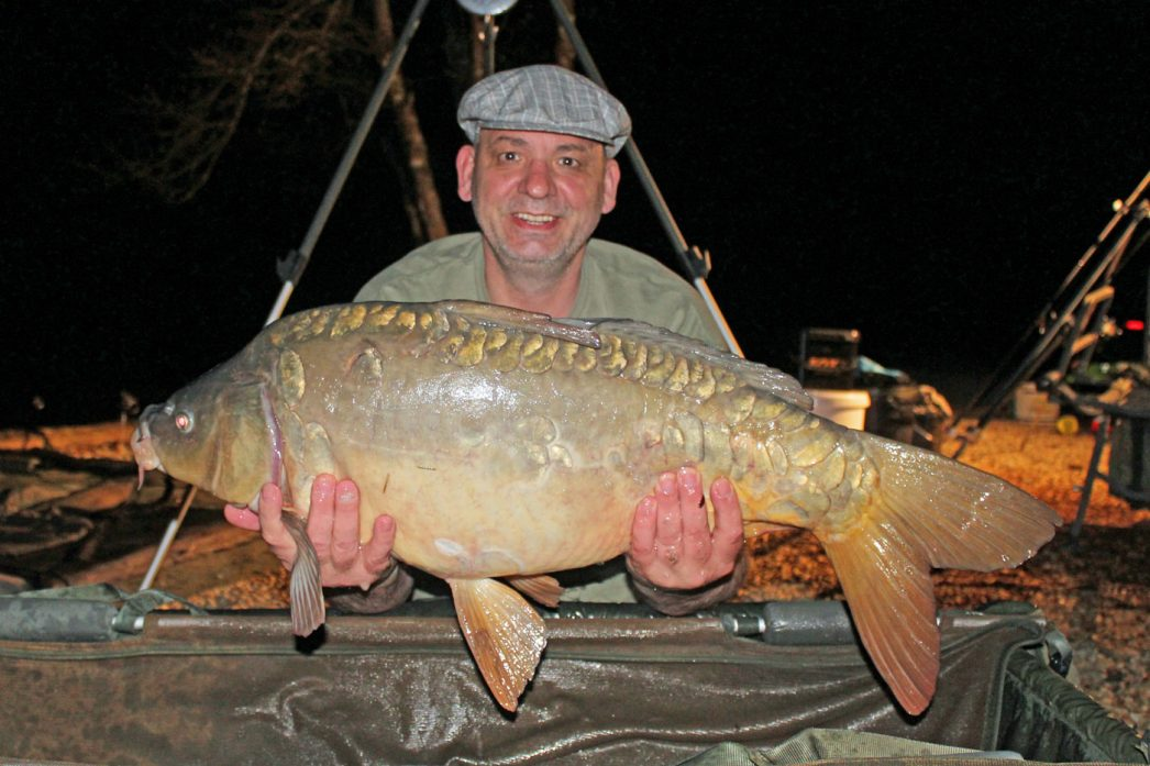 Alex with a mirror carp of 28 pounds