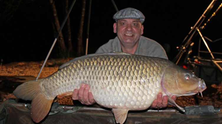 Alex with a common carp of 33lbs