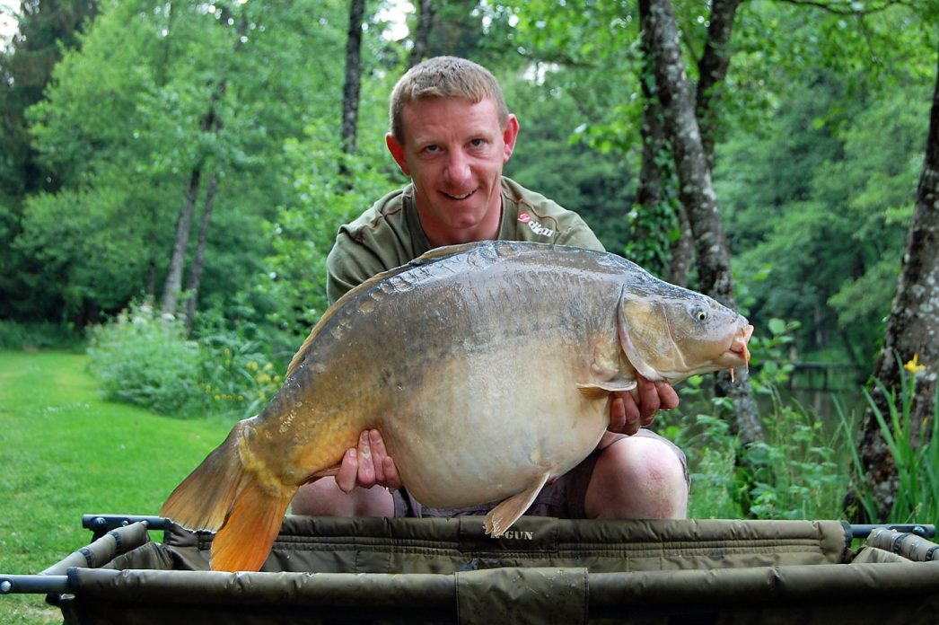 John with Domino at 31lbs mirror carp france