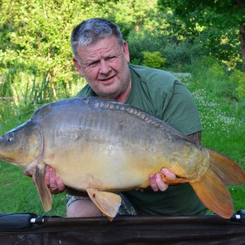 Tony with Batman at 30lbs mirror carp france