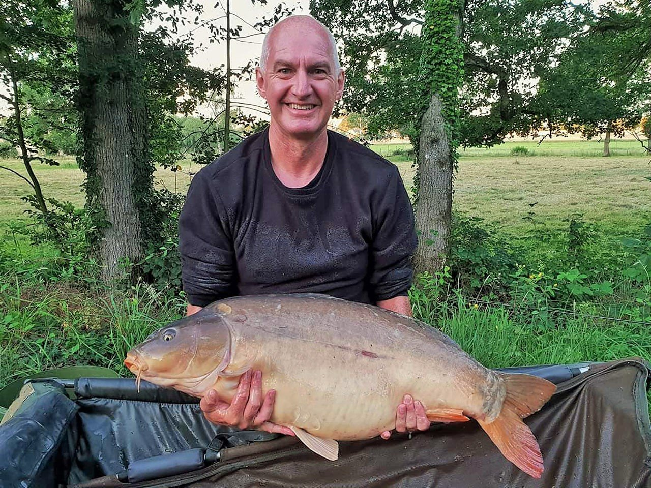 Dave with Lily at 36lbs mirror carp in france