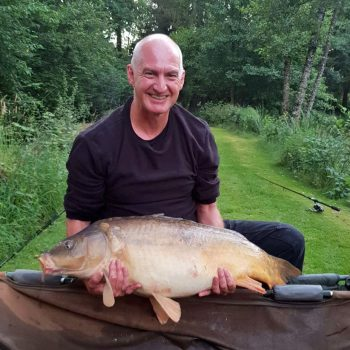 Dave with Petals at 31lbs mirror carp in france