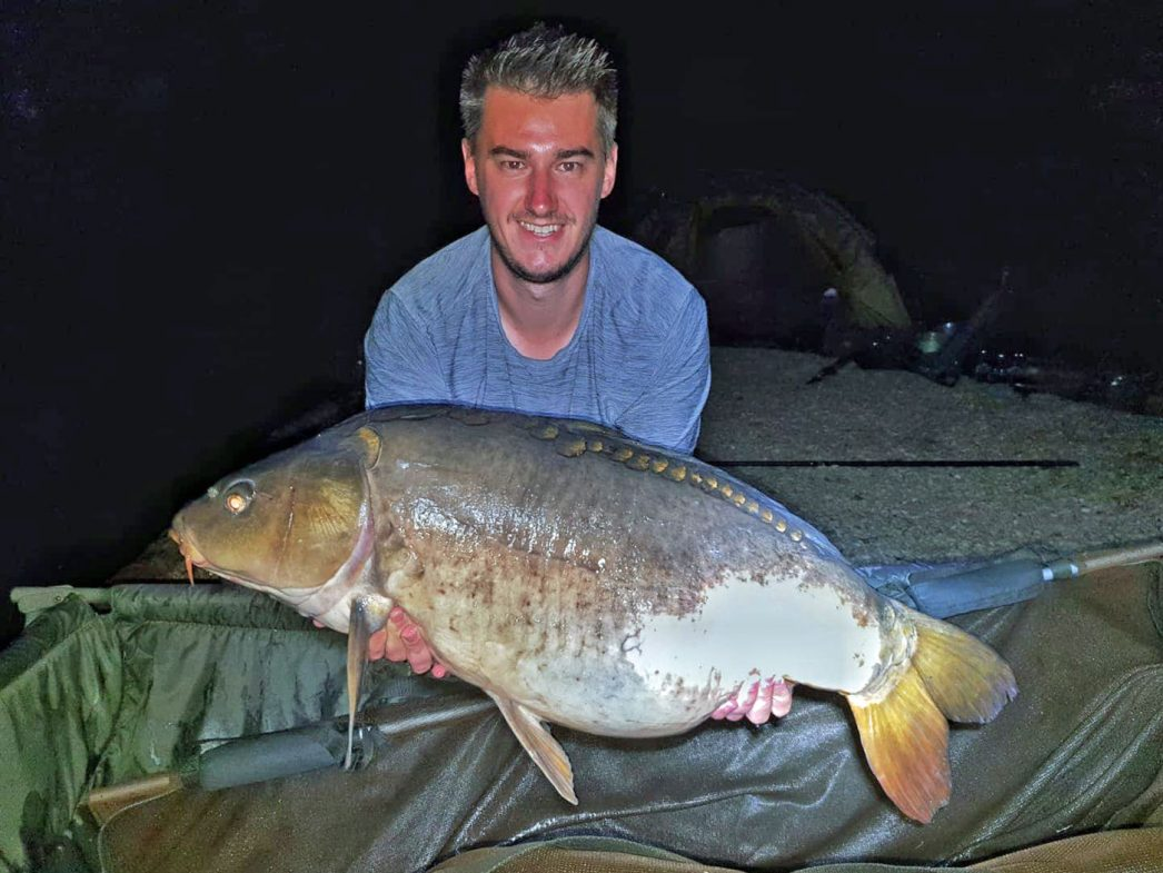 Luke with Moonscale at 31lbs mirror carp