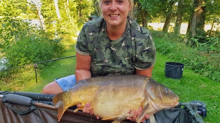 Sarah with Claws at 30lbs mirror carp in france