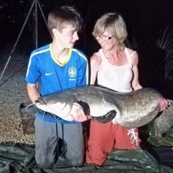 Tania with a 57lb catfish