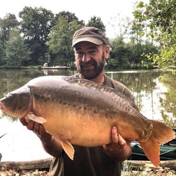 Chris with Coins at 31lbs 8oz mirror carp