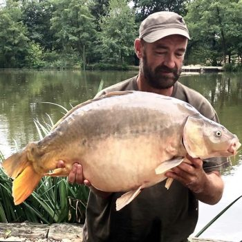 Chris with Domino at 31lbs 8oz mirror carp