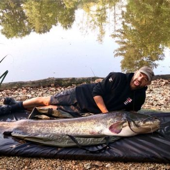 Chris with an 84lbs catfish