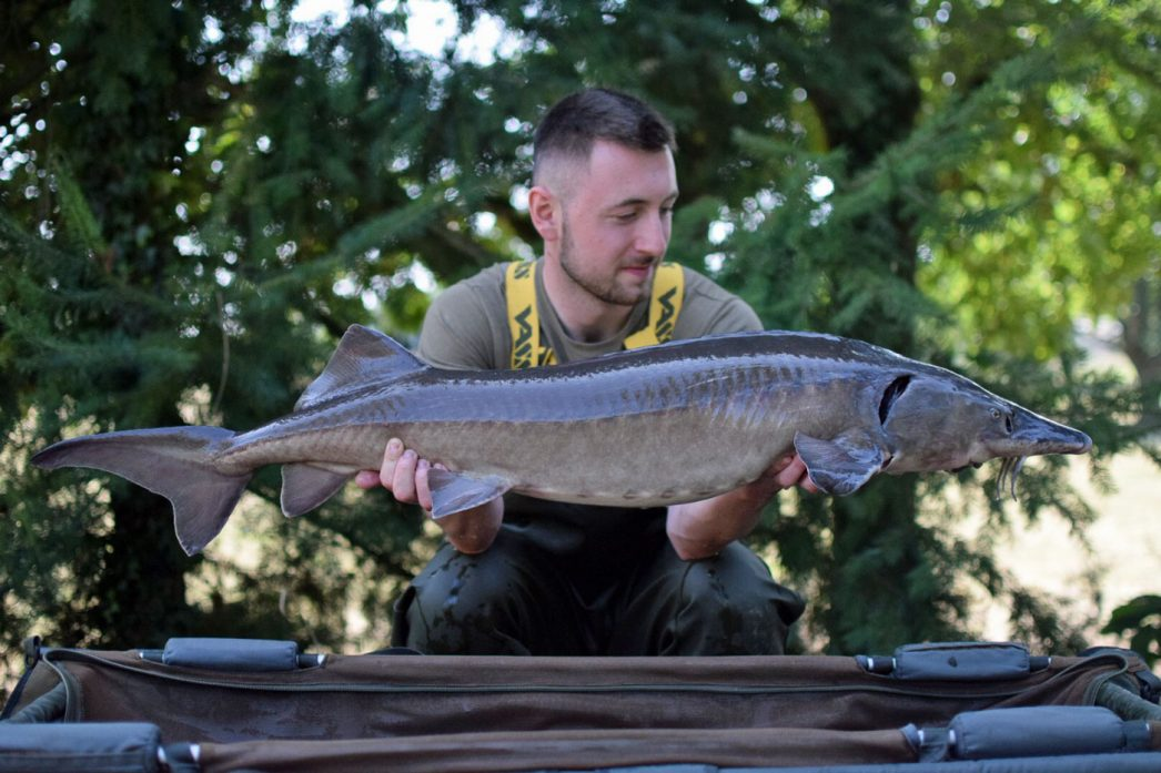Max with the sturgeon at 24lbs 12oz