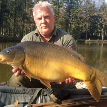 Carp angler in France Nik with a mirror carp of 25lbs 8oz
