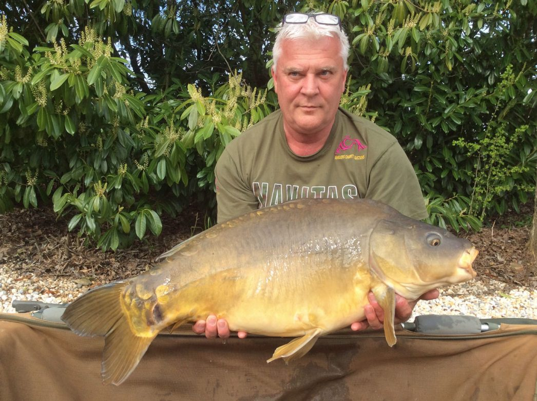 carp angler in france nik with a mirror carp of 26lbs 8oz