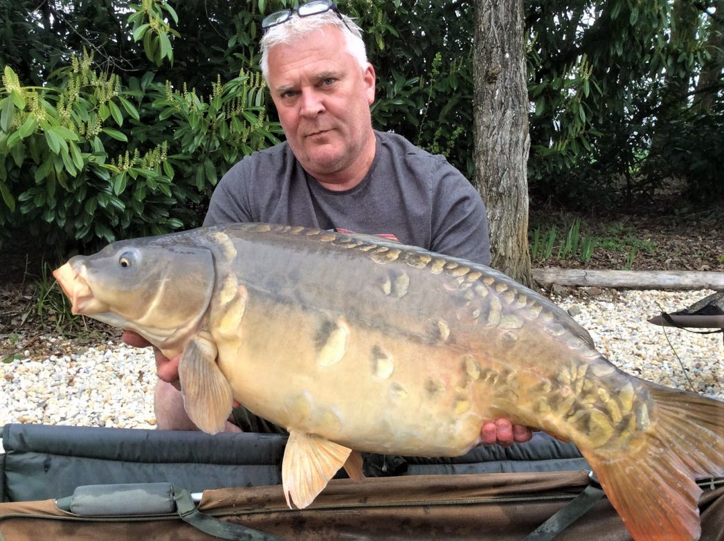 Carp angler Nik with a mirror carp of 39lbs in France